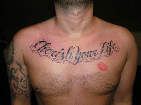 kiss tattoo on chest meaning 27 strong chest tattoos for 2013