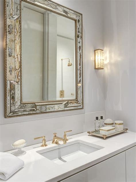 White Gold Bathroom by Antiqued Mirrored Bathroom Vanity With White Marble Top