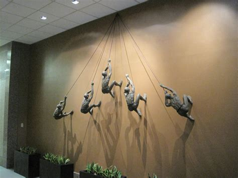 Decorative Shelves Home Depot by Climbing Man Wall Sculpture Photo Home Furniture Ideas