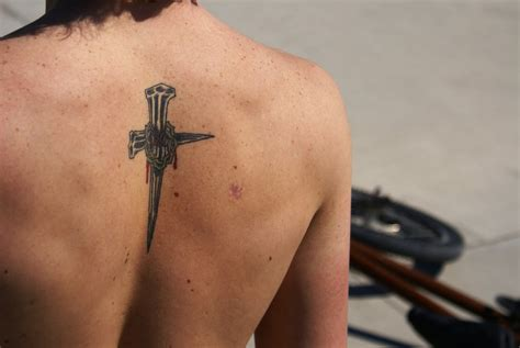cross tattoo on upper back 8 christian tattoos on back