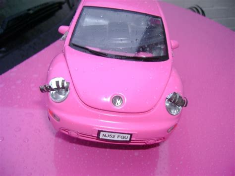 pink volkswagen beetle with eyelashes volkswagen beetle pink with eyelashes