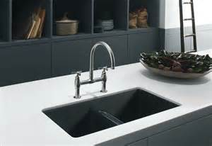 attractive How To Install Stainless Steel Kitchen Sink #4: white-countertop-feat-cool-black-undermount-sinks-design-ideas-and-chrome-faucet-plus-open-shelves.jpg