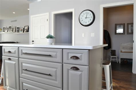bright white kitchen with bronze hardware pictures to pin laurenrae and company our kitchen