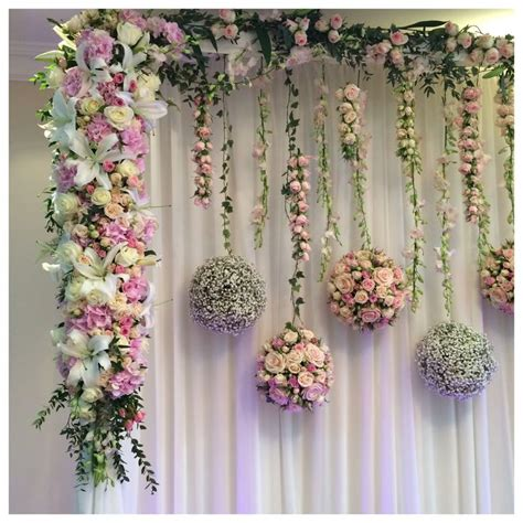 Wedding Backdrop Board by Hanging Flower Balls With A Solid Flower Edging Stage