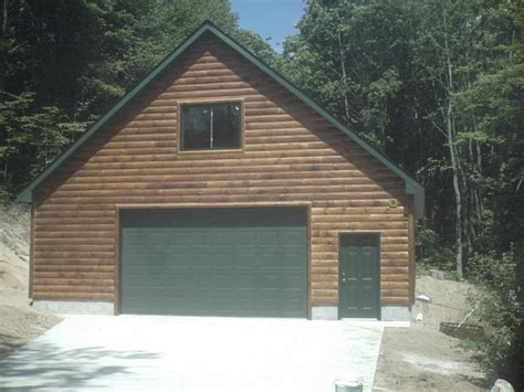 garage with loft and 1 4 log siding from ac construction