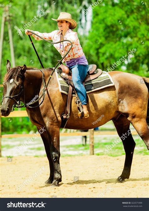 Training Active Ranch | active western cowgirl woman hat training stock photo