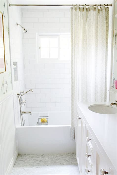 bathtub shower curtain surround long white and beige bathroom with white bombay washstand