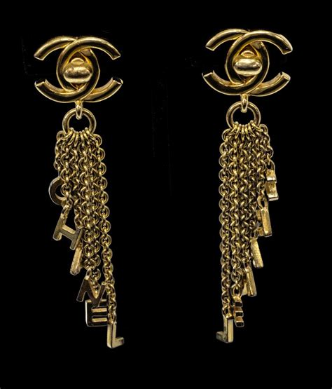 chanel cc turnlock letter chain gold tone earrings