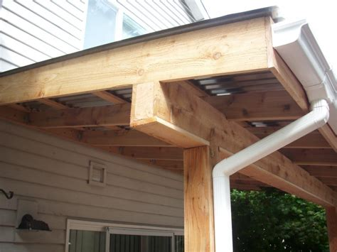 Aluminum Beams For Patio Covers by Corrugated Patio Cover Cedar Wrapped Post And Beam Deck