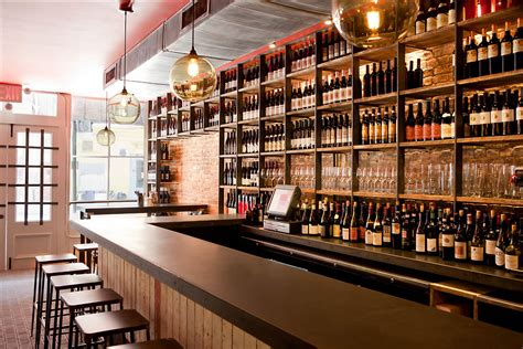 top wine bars terroir wine bar nyc the concrete and wine bottles are