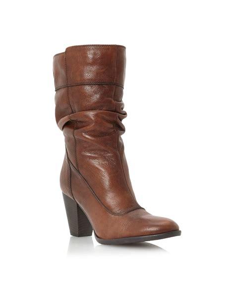 dune boots dune rad slouch block heel calf boots in brown lyst