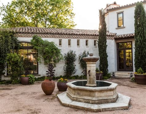 spanish courtyard designs traditional water fountain using clay vases for elegant