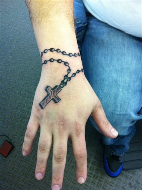 rosary cross hand tattoo