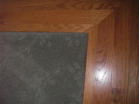 Hardwood Floor On Carpet by Carpet Inlay Wood Floor Bordering 3 Around Room Wall