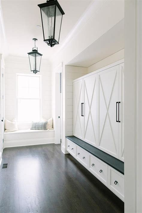 mudroom with seeded glass lanterns transitional