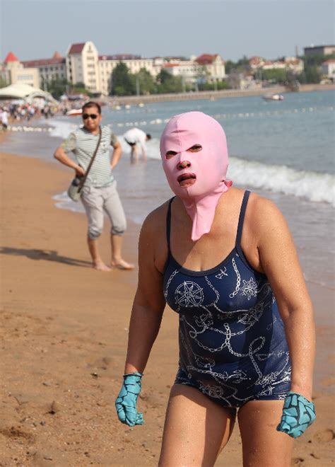 middle aged women in bathing suits female sunbathers opt for face bikini 1 chinadaily com cn