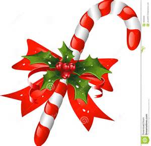 christmas candy cane decorated with a bow and holl stock