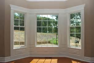 Wood Panel Windows Designs Integrate Window And Door Trim With Wainscoting Panels