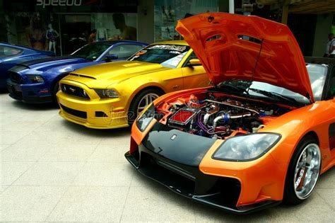 Less Expensive Cars by Expensive And Customized Luxury And Race Cars Editorial