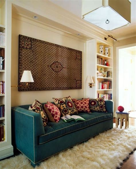 floor cushions instead of couch love the built in bookcases creating a cozy space for the