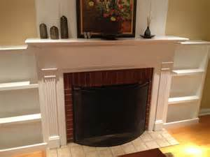 white fireplace facelift built in bookcases diy projects