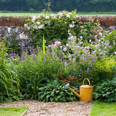 country garden style abundantly planted borders spacious wiltshire garden