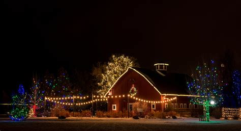 country barn decorated with christmas lights photograph by
