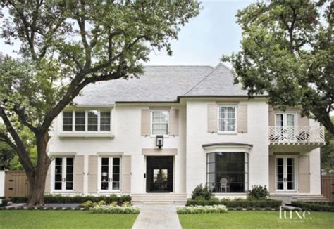 a white painted brick dallas residence exudes southern style luxe