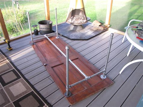 diy door table legs diy table made from an door and galvanized pipe