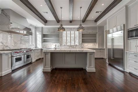 kitchen open white kitchen center island corner white and gray kitchen features a tray ceiling lined with