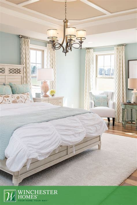 light green bedroom walls double hung windows welcome natural light in to illuminate