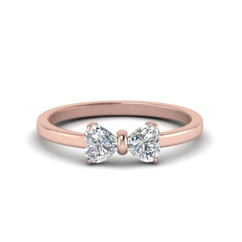 2 heart shaped bow diamond ring in 18k rose gold