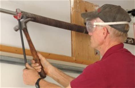 Diy Garage Door Springs by How To Replace Garage Door Torsion Springs