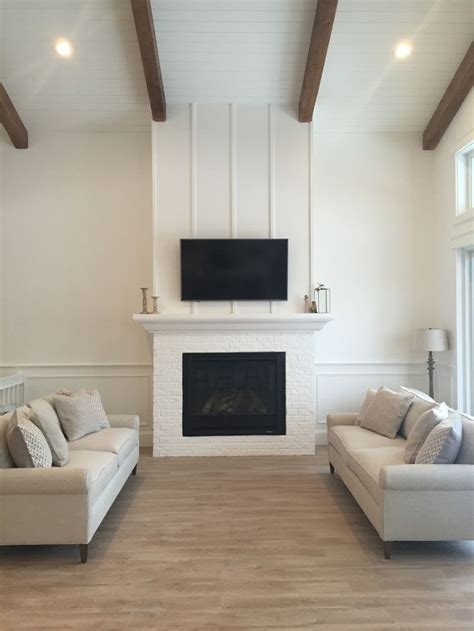 white living room  shiplap ceiling woods beams
