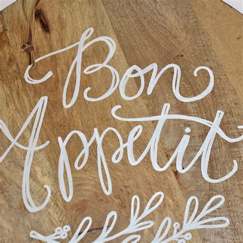 Home Decor Wholesale Market quot bon appetit quot calligraphy quote round cutting board ec s