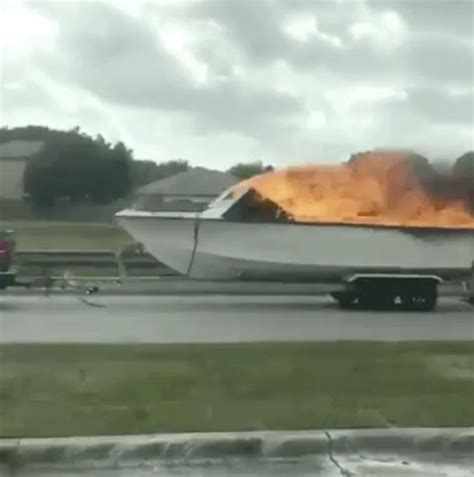 boat on fire driving down road viral video shows shocking moment driver sees boat on fire