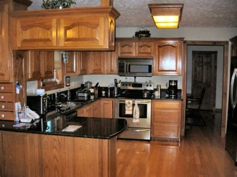 black quartz countertops with oak cabinets dark oak kitchen cabinets file name kitchen colors