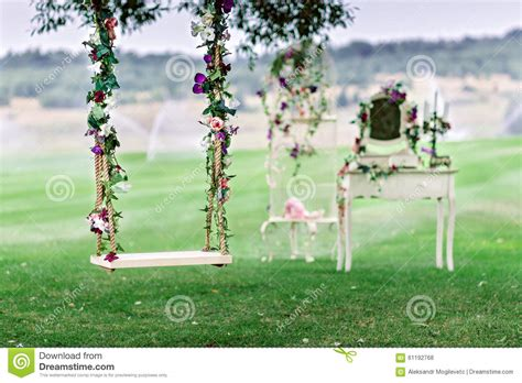 is swinging good for a marriage wedding swing decorated with flowers stock photo image