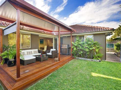 Landscaped garden design using grass with deck amp outdoor furniture