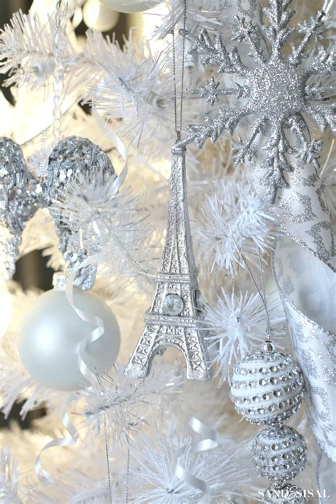 white ornaments for a tree a winter tree sand and sisal