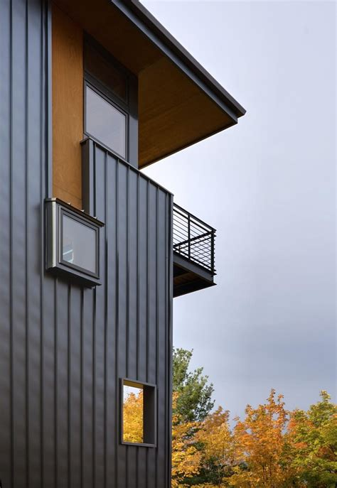 storey tall house reaches   forest    lake