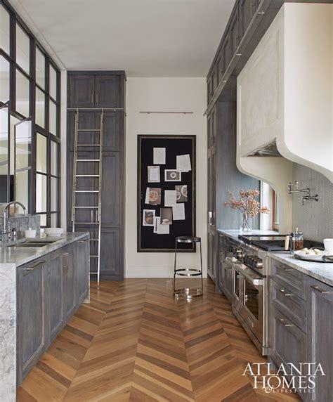 wood herringbone floor contemporary kitchen nate gray distressed kitchen cabinets with marble herringbone