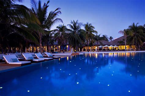 pool at night velassaru maldives image bank