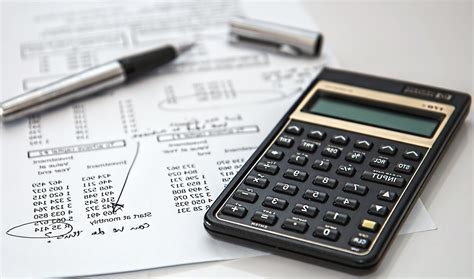Free picture: calculator, pen, paper, finance, business, economy, technology