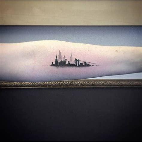 inner city tattoo single needle new york skyline on the left inner
