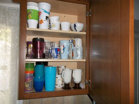 how to arrange kitchen cabinets how to organize cabinets organizing under the kitchen