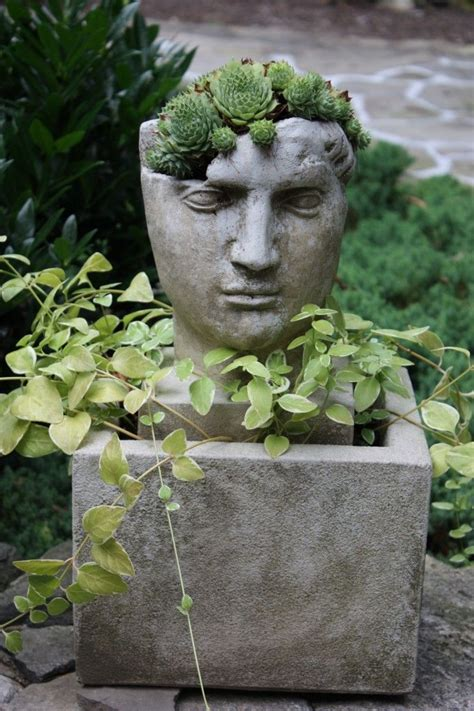 face planters the artful garden pot heads stone face planters
