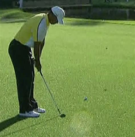golf swing divot after ball masters 2013 tiger woods dropped ball significantly