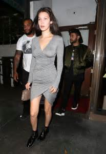 Gorgeous in clinging grey dress on romantic date night with the weeknd