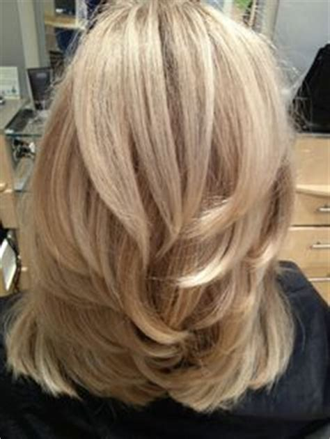back of head layered blonde hair styles long layered haircuts back view medium length layered